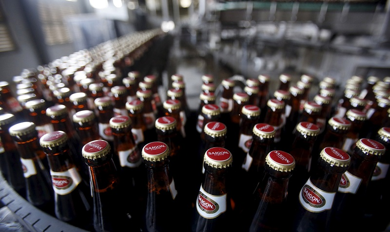 Bottles of beer move along a production line of a Sabeco factory in Hanoi, Vietnam