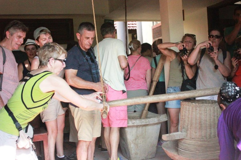 A file photo of foreign tourists visiting an exhibition on farming tools in the central province of Thua Thien-Hue. Photo: Dinh Toan/Thanh Nien